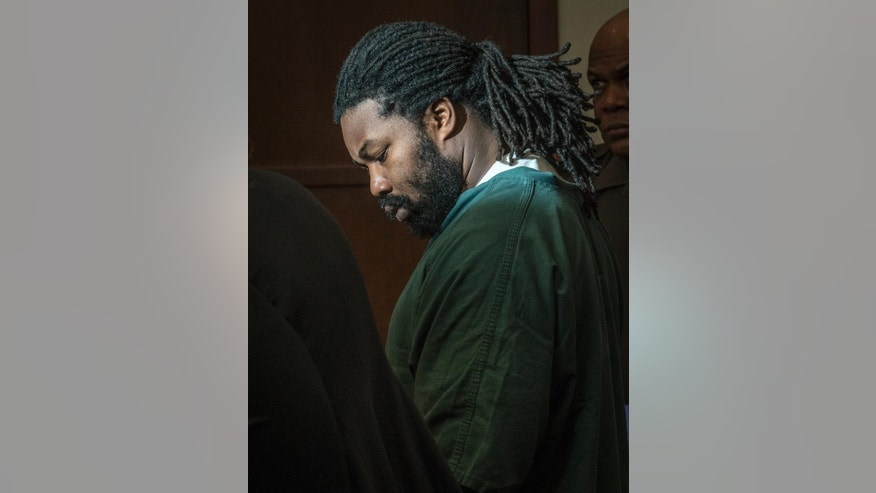 Jesse Matthew, right, glances down while appearing in court on Friday, Nov. 14, 2014 in Fairfax, Va.  Matthew, accused of abducting Hannah Graham, a University of Virginia student who was found dead last month,  pleaded not guilty Friday on an unrelated sexual assault charge. Matthew, 32, is charged with attempted capital murder and other counts stemming from a September 2005 attack on a 26-year-old woman in Fairfax City.   (AP Photo/The Washington Post, Bill O'Leary, Pool)