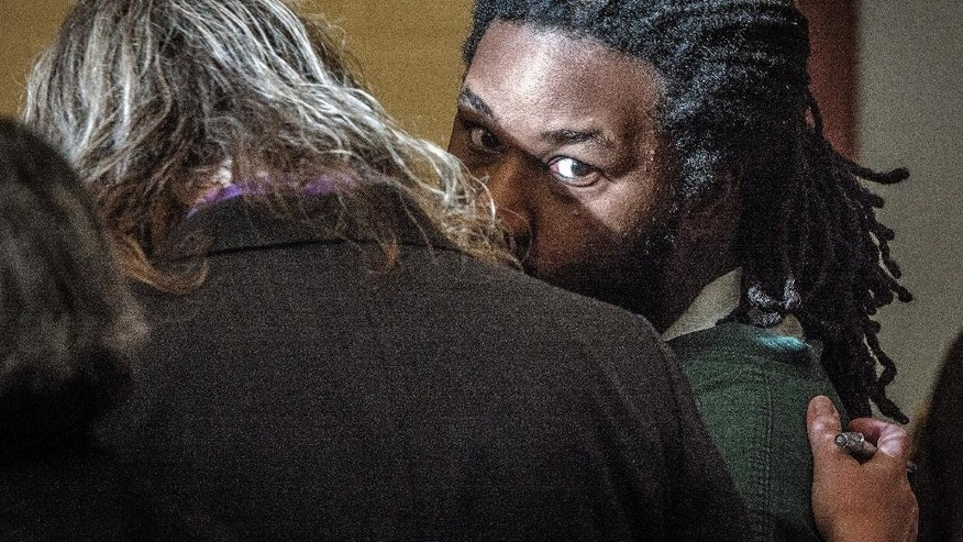 Jesse Matthew, right, confers with an attorney while appearing in court on Friday, Nov. 14, 2014, in Fairfax, Va.  Matthew, accused of abducting Hannah Graham, a University of Virginia student who was found dead last month, pleaded not guilty Friday on an unrelated sexual assault charge. Matthew, 32, is charged with attempted capital murder and other counts stemming from a September 2005 attack on a 26-year-old woman in Fairfax City. (AP Photo/The Washington Post, Bill O'Leary, Pool)