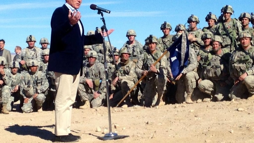 U.S. Secretary of Defense Chuck Hagel speaks to members of 3rd Brigade, 4th Infantry Division, at the National Training Center in Fort Irwin, Calif. on Sunday, Nov. 16, 2014. Wary of a more muscular Russia and China, Hagel said Saturday the Pentagon will make a new push for fresh thinking about how the U.S. can keep and extend its military superiority despite tighter budgets and the wear and tear of 13 years of war. (AP Photo/Robert Burns)