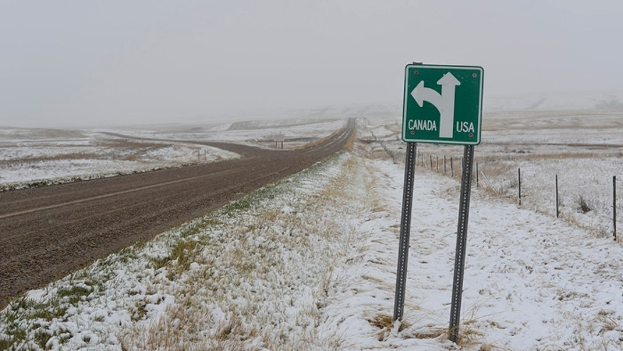 A sign indicates a crossroads along the U.S./Canada border in rural northern Montana. (FoxNews.com)