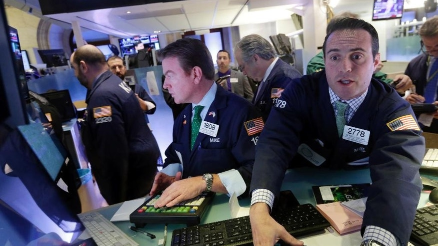 "Specialists Michael O""Mara, left, and Michael Gagliano, work at their posts on the floor of the New York Stock Exchange Monday, Nov. 17, 2014. U.S. stocks are mostly lower in early trading following a sharp drop in Japan overnight. (AP Photo/Richard Drew)"