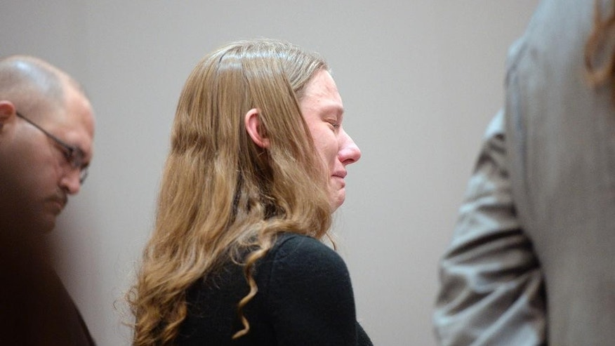 Stephanie Sloop, charged with aggravated murder in the 2010 death of her son, Ethan Stacy, listens to proceedings in Farmington, Utah, where she pleaded guilty on Monday, Nov. 17, 2014. She was sentenced to twenty years to life. (AP Photo/The Salt Lake Tribune, Al Hartmann, Pool)