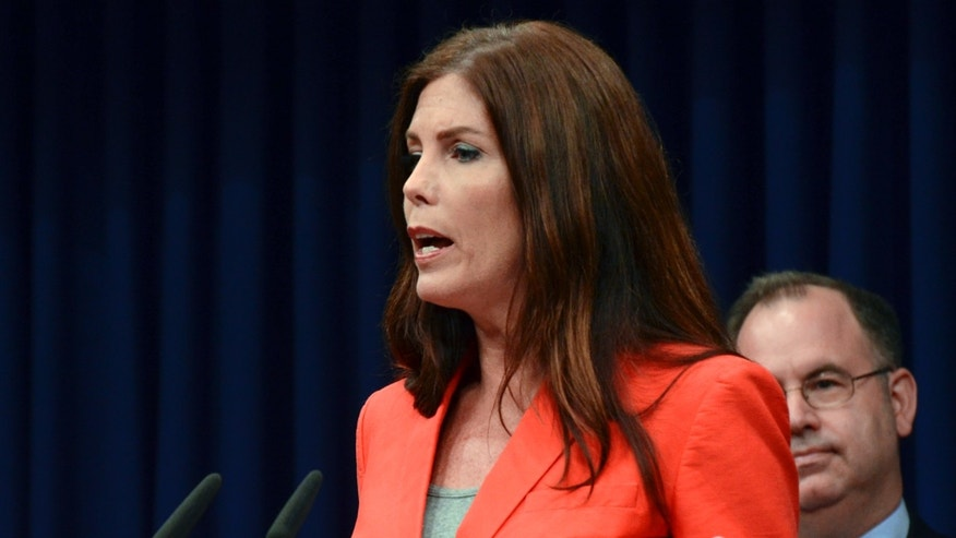 June 27, 2014: Attorney General Kathleen Kane speaks during a news conference, at the Capitol in Harrisburg, Pa.