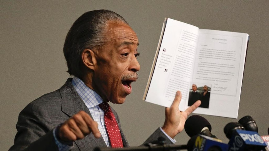 The Rev. Al Sharpton speaks during a news conference, Wednesday, Nov. 19, 2014, in New York. Sharpton spoke about his plans for the pending grand jury decisions in the deaths of Michael Brown in a St. Louis suburb and Eric Garner in New York and also addressed tax allegations in a New York Times story. (AP Photo/Julie Jacobson)