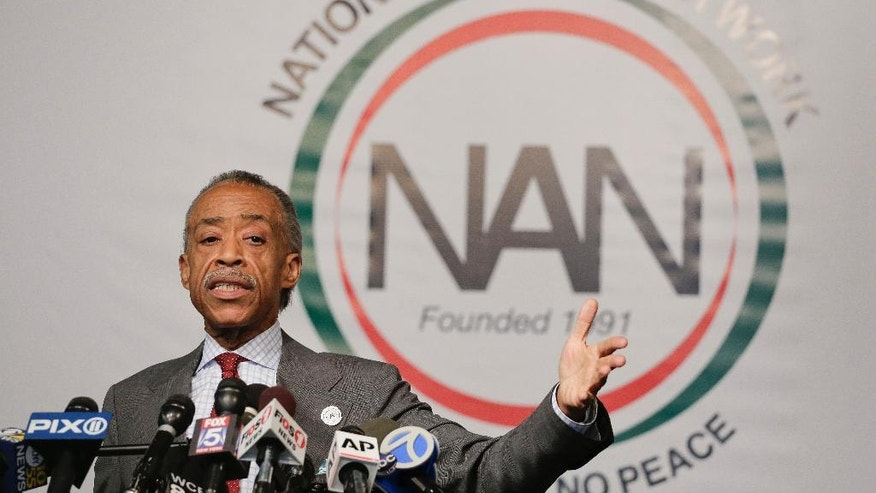 The Rev. Al Sharpton speaks during a news conference, Wednesday, Nov. 19, 2014, in New York. Sharpton spoke about his plans for thepending grand jury decisions in the deaths of Michael Brown in a St. Louis suburb and Eric Garner in New York and also addressed tax allegations in a New York Times story. (AP Photo/Julie Jacobson)