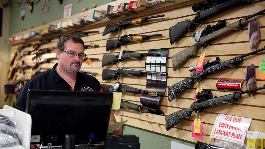 Nov. 15, 2014: Steven King works behind the counter at at Metro Shooting Supplies, in Bridgeton, Mo.