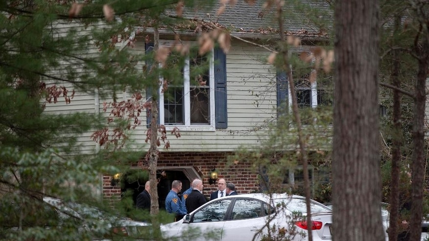 Members of law enforcement gather at the scene of a shooting Thursday, Nov. 20, 2014, in Tabernacle, N.J. New Jersey State Police say two people are dead and two were found wounded in a shooting at the southern New Jersey home. (AP Photo/Matt Rourke)