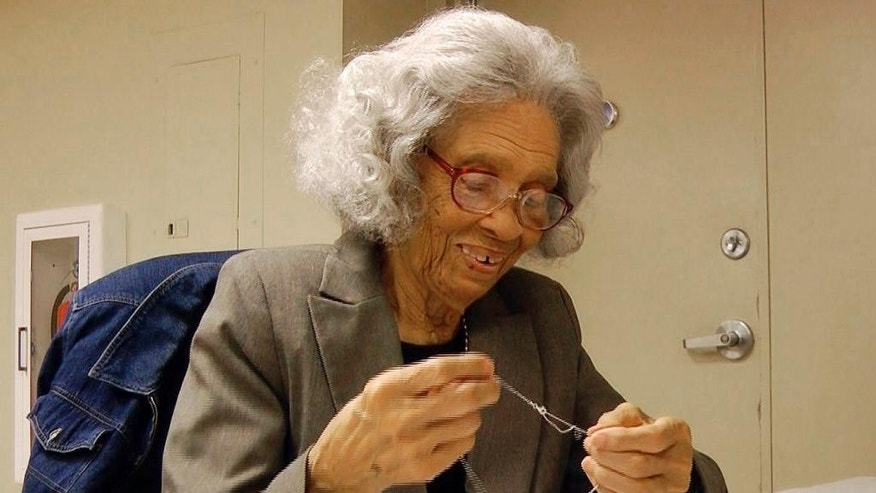 In a Tuesday, Nov. 18, 2014 image from video, Frances Moore, 93, puts a tag on a necklace at Bromberg & Co. jewelry in Mountain Brook, Ala. Moore, who has worked for the company for 75 years, is the longest-tenured employee ever at a family-owned company that dates to 1836. (AP Photo/Jay Reeves)