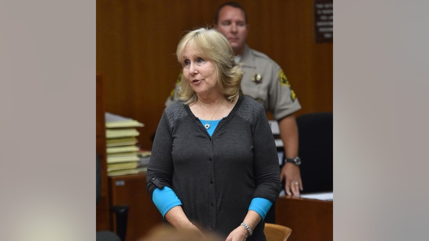 Susan Mellen talks briefly to Judge Mark Arnold in Torrance Superior Court where she was declared factually innocent for a murder she spent 17 years in prison for, Friday, Nov. 21, 2014, in Torrance, Calif.  Arnold previously overturned Mellen's conviction in the 1997 beating death of a homeless man. Her conviction was based on the testimony of a notorious liar. Prosecutors agreed Mellen was wrongly convicted.  (AP Photo/The Daily Breeze, Brad Graverson)  MAGS OUT; NO SALES