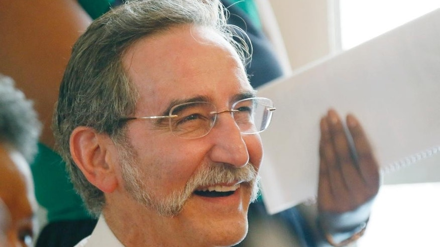 "In this June 15, 2014 photograph, David Goodman, the brother of Andrew Goodman, one of three civil rights workers killed in the ""Mississippi Burning"" case of 1964, laughs during a commemorative service for the three men at Mt. Zion United Methodist Church in Philadelphia, Miss  Andrew Goodman, Michael Schwerner and James Chaney are going to be posthumously awarded the Presidential Medal of Freedom on Monday, Nov. 24, 2014, but the honor is not sitting well with some of their relatives. (AP Photo/Rogelio V. Solis)"