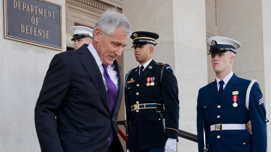 Defense Secretary Chuck Hagel walks down the steps of the Pentagon to welcome New Zealand's Minister of Defense Gerry Brownlee, during an honor cordon, Monday, Nov. 24, 2014.   (AP Photo/Manuel Balce Ceneta)