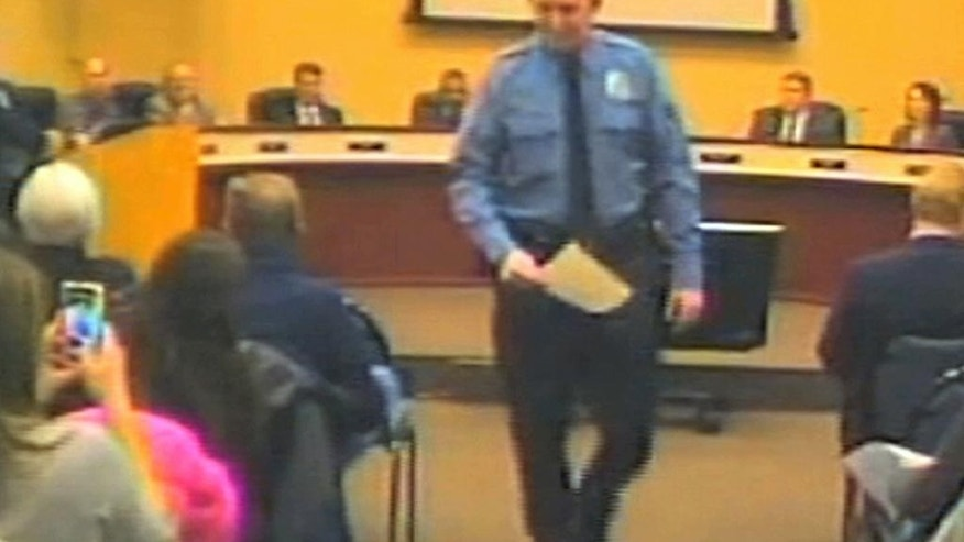 FILE - In this file Feb. 11, 2014 image from video released by the City of Ferguson, Mo., is officer Darren Wilson at a city council meeting in Ferguson. A  grand jury said Monday, Nov. 24, 2014 that it has reached a decision about whether to indict Wilsoin in the shooting death of Michael Brown, according to a lawyer for Brown's family. (AP Photo/City of Ferguson)