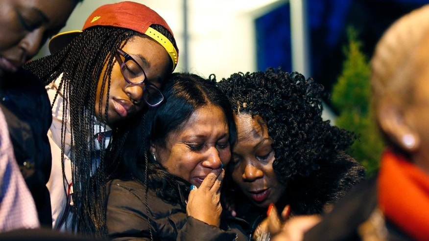 Nyela Williams, left in hat, Barbara Jones,center, a longtime employee of former Mayor Barry, and Dawn Perry, right, comfort each other during a vigil to honor former Mayor and current DC City Council member Marion Barry, Sunday, Nov. 23, 2014, in Washington. Barry, who staged a comeback after a 1990 crack cocaine arrest, died early Sunday, Nov. 23, 2014. He was 78. (AP Photo/Alex Brandon)
