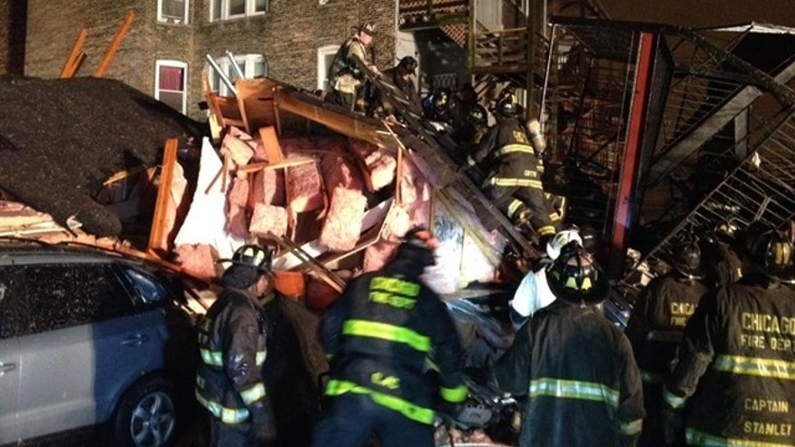 November 23, 2014: Chicago firefighters sift through the rubble of an apartment building that collapsed after a possible gas explosion on the city's South Side Sunday evening. (MyFoxChicago.com)