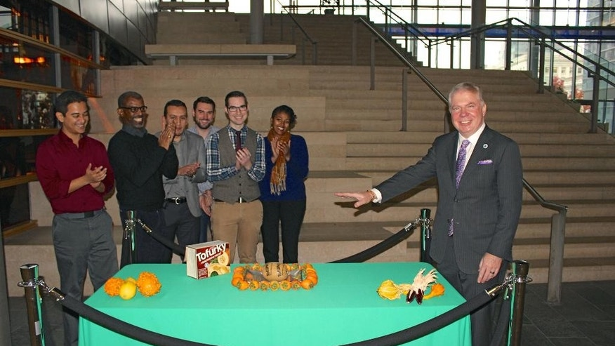 "In this Nov. 21, 2014 photo provided by the office of Seattle Mayor Ed Murray, Murray poses for a photo as he ""pardons"" a Tofurky, a soy-based turkey alternative, at Seattle City Hall. The ceremony was a twist on the traditional presidential turkey pardon. (AP Photo/ Seattle Mayor's Office)"