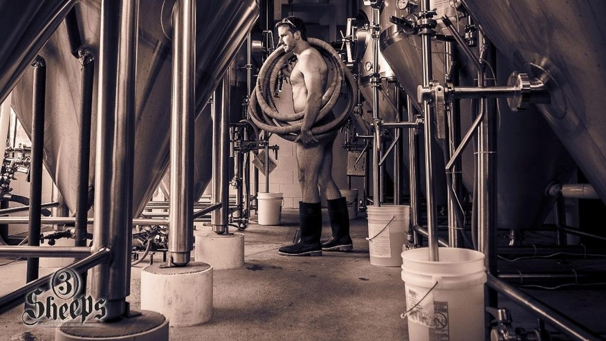 This undated photo provided by Brew Men Calendar, shows the photograph for the month of June in the 2015 Brew Men Calendar, which features brewers from Sheboygan County, Wis. The 2015 Brew Men Calendar features brewing professionals from 3 Sheeps Brewing, 8th Street Ale Haus and Plymouth Brewing Co. Proceeds from calendar sales will be donated to the Movember Foundation, a non-profit organization focused on men's health issues, including prostate and testicular cancer. (AP Photo/Brew Men Calendar, Mike Wiesman) MANDATORY CREDIT