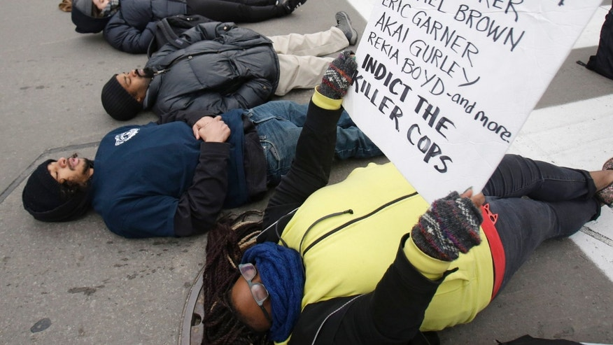 Nov. 25, 2014: Demonstrators lay down in Public Square