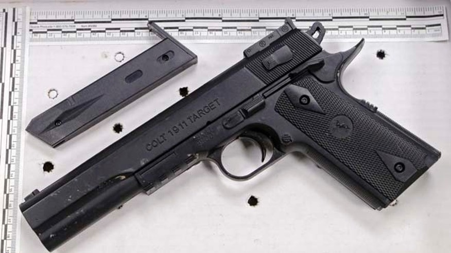 Nov. 26, 2014: This fake handgun taken from 12-year-old Tamir Rice, who was fatally shot by Cleveland police over the weekend, is displayed after a news conference Wednesday. The 12-year-old was shot at a city park  after he reportedly pulled the Colt 1911 replica on arriving officers.