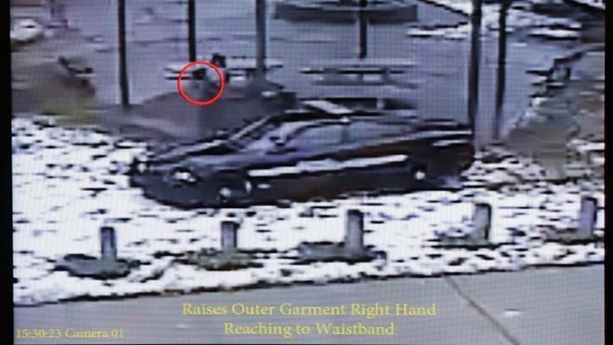 Nov. 26, 2014: This still image taken from a surveillance video played at a news conference held by Cleveland Police, shows Cleveland police officers arriving at Cudell Park on a report of a man with a gun.