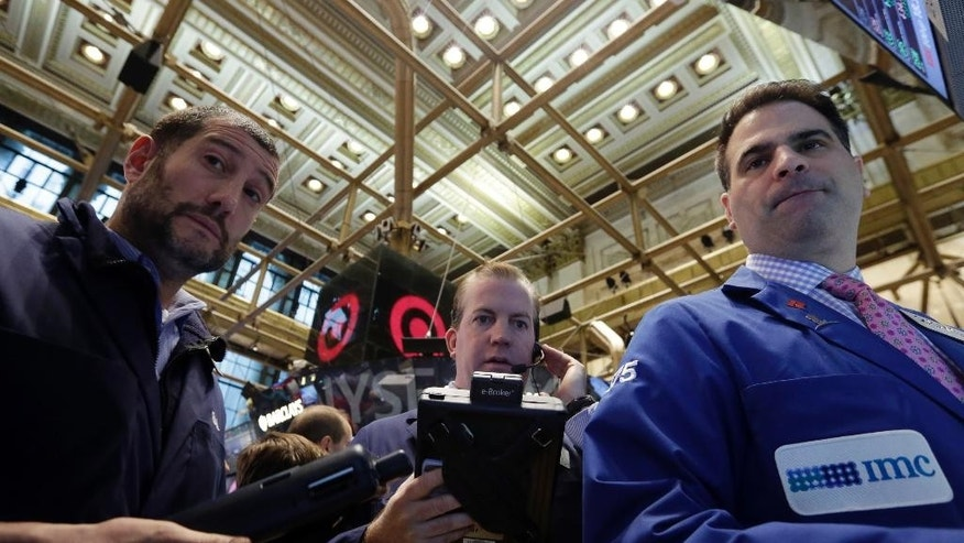 Trader work at the post of specialist Michael Urizzo, right, on the floor of the New York Stock Exchange, Friday, Nov. 28, 2014. U.S. stocks indexes were mixed in early trading, as tumbling oil prices weighed on shares of Exxon Mobil, Chevron and other oil and gas giants. Airlines, however, made gains. (AP Photo/Richard Drew)