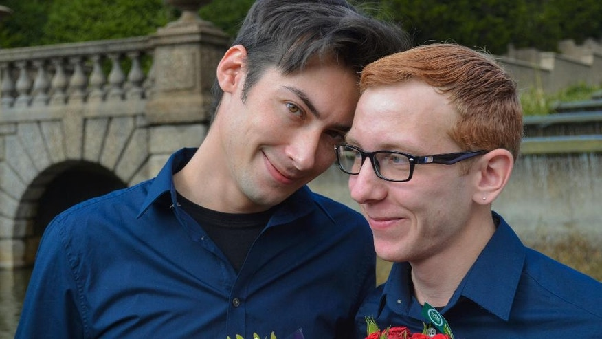 In this Oct. 18, 2014, photo provided by Michael Knaapen, Andrew Nasonov, right, and Igor Bazilevsky, pose for a photo after the couple was married at Meridian Hill Park in Washington. They both came to the U.S. from Russia in July, and are preparing to file an application seeking asylum in the U.S. The increase in the overall applications for asylum by Russians is due in part to the worsening anti-gay climate in Russia, according to Immigration Equality, a New York-based organization which provides legal services for lesbian, gay, bisexual and transgender immigrants. (AP Photo/Michael Knaapen)