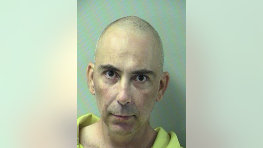Nov. 30, 2014: This photo provided by the Okaloosa County Department of Corrections shows Michael Watkins in a booking photo in Crestview, Fla.  The Florida man was charged with murder after he told police he shot his mother with a gun and a bow-and-arrow then stabbed her.
