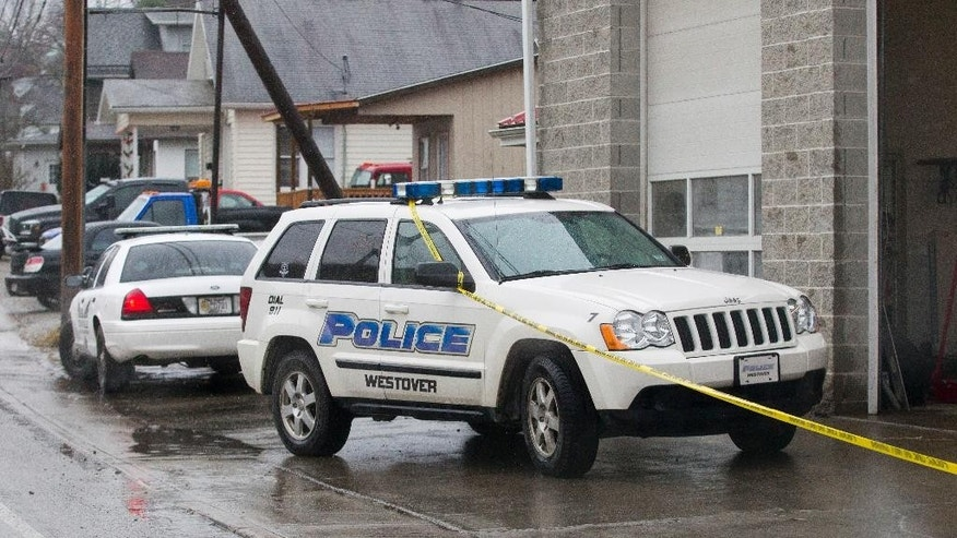 Westover Police vehicles are parked outside Doug's Towing in Westover, W.V.,, Monday, Dec. 1, 2014, after three separate shootings left four people dead on Monday. State police said they're seeking one suspect in all the shootings. Monongalia County 911 director Mike Wolfe said police are seeking Jody Lee Hunt, 39, of Westover. Police also are searching for a 2011 Ford F-150 extended cab truck. (AP Photo/Ben Queen)