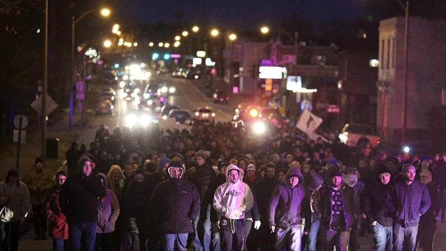 Bosnians march along Gravois Road on Monday, Dec. 1, 2014 to protest the murder of Zemir Begic, a Bosnian man, in St. Louis.  Police blocked traffic as hundreds of people marched from Holly Hills Avenue down Gravois Road to Itaska Street where Begic was killed early Sunday, Nov. 30, 2014. Police in St. Louis say they've arrested two juveniles and are looking for two other suspects in the killing of a Begic, a Florida man who was beaten to death with hammers. (AP Photo/St. Louis Post-Dispatch, David Carson)  EDWARDSVILLE INTELLIGENCER OUT; THE ALTON TELEGRAPH OUT