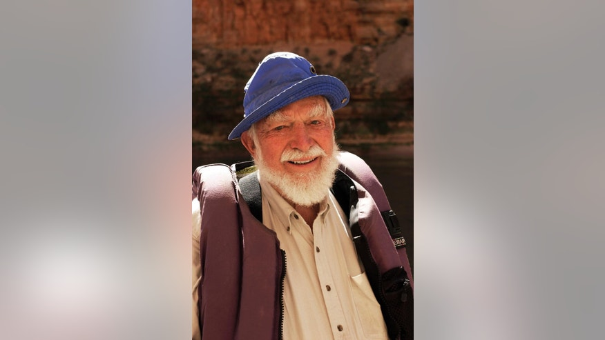 In this April 16, 2004 photo provided courtesy of Sequoia ForestKeeper, shows its president, Martin Litton at the Grand Canyon National Park, Nev.  Litton, a legendary Colorado River guide and fierce wilderness advocate involved in some of the 20th century's biggest conservation battles, has died. He was 97. Litton died Sunday, Nov. 30, 2014, evening of age-related causes at his home in Portola Valley, Calif., said his son Donald. (AP Photo/Sequoia ForestKeeper, John Blaustein)