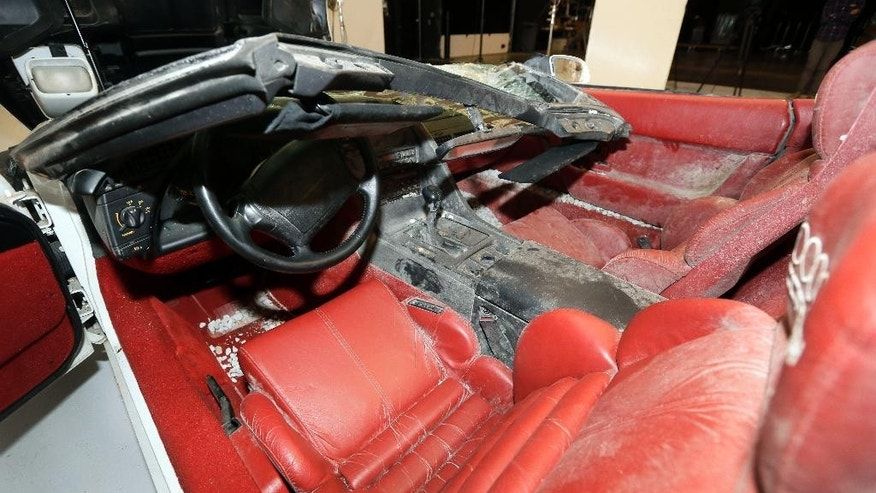 The 1,000,000th Chevrolet Corvette, a 1992 convertible model, is on display at Stage 3 Studio in Warren, Mich., Wednesday, Dec. 3, 2014. The car was one of eight classic and historic Corvettes extracted from the sinkhole in the floor of the National Corvette Museum in Bowling Green, Ky., in February. The car will undergo restoration by General Motors' Design Center Fabrication Operations in January and will take at least six months to complete. (AP Photo/Carlos Osorio)