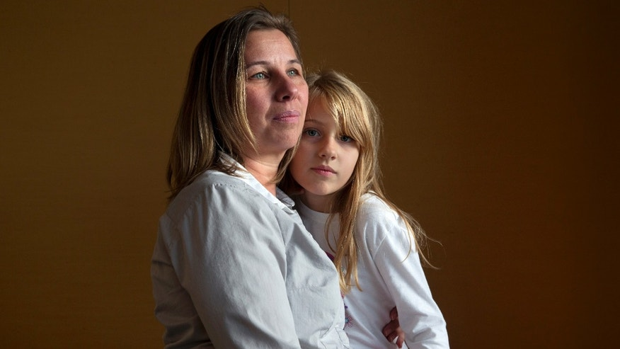 Nov. 14, 2014: Peggy Young, of Lorton, Va., with her daughter Triniti, 7, in Washington.