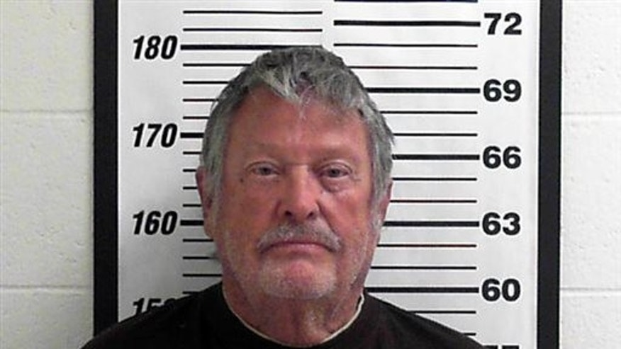 In this undated photo provided by the Davis County Jail Myron Lee Kipp poses for a booking photo, in Utah.