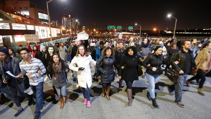 Dec. 3, 2014: eople march in protest on the West Side Highway after it was announced that the New York City police officer involved in the death of Eric Garner was not indicted