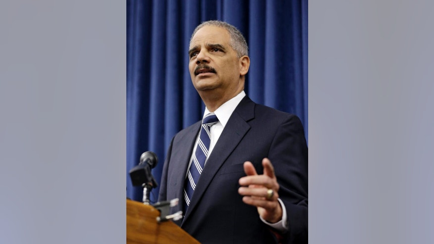 U. S. Attorney General Eric Holder speaks during a news-conference before a roundtable meeting Thursday, Dec. 4, 2014, in Cleveland. The US Justice Department issued a report Thursday that says Cleveland police officers use excessive and unnecessary force far too often, are poorly trained in tactics and firearm use and place the public and their fellow officers in danger because of reckless behaviors. (AP Photo/Tony Dejak)