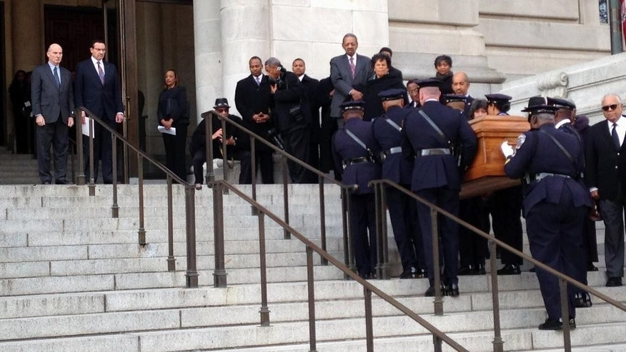 District of Columbia police officers carry the casket of former Mayor Marion Barry up the steps of the John A. Wilson Building in Washington, Thursday, Dec. 4, 2014, to be greeted by Mayor Vincent Gray and D.C. Council Chairman Phil Mendelson. Barry died Nov. 23 at age 78. His remains were to lie in repose at the Wilson Building, the District's city hall, for 24 hours. (AP Photo/Ben Nuckols)