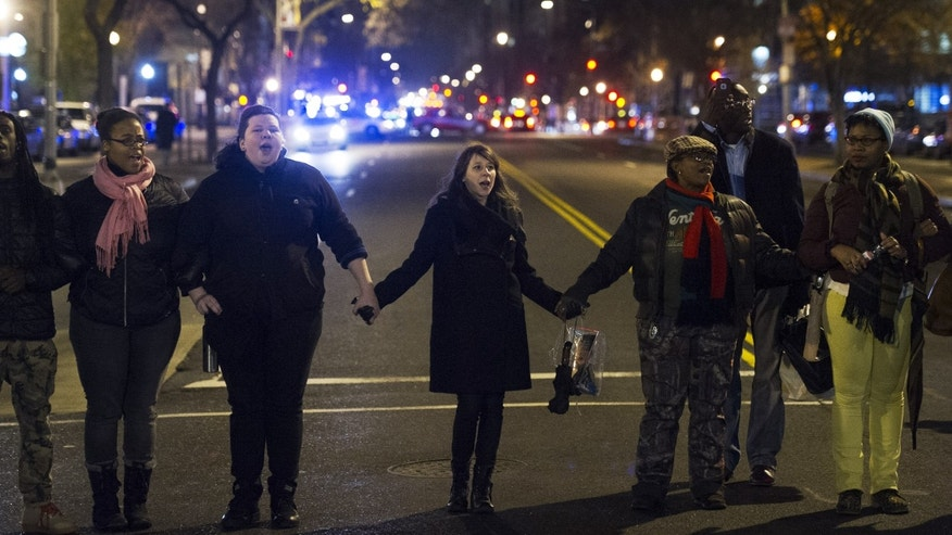 Dec. 5, 2014: Protestors block an intersection in downtown Washington.