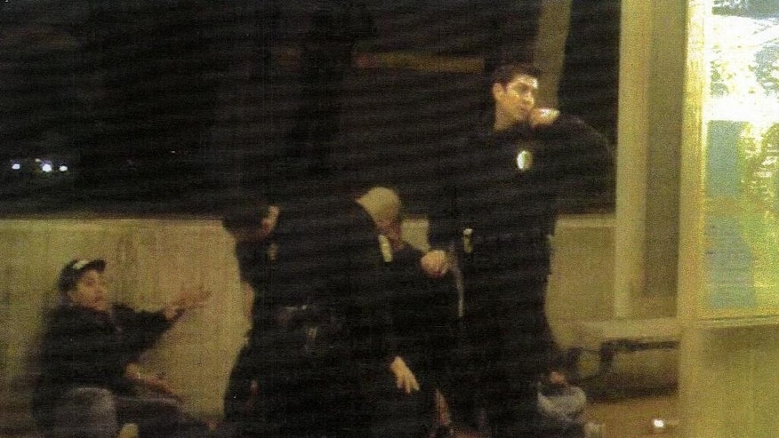 FILE- This file image provided by the Los Angeles County Superior Court shows police at the scene where Oscar Grant was shot by former San Francisco Bay Area Rapid Transit police officer, Johannes Mehserle on an Oakland, Calif., train platform on New Year's Day 2009.  The former transit officer was convicted of involuntary manslaughter in the shooting death of Grant.  At least 400 people are killed by police officers in the United States every year, and while the circumstances of each case are different, one thing remains constant: In only a handful of instances do grand juries issue an indictment, concluding that the officer has committed a crime.   (AP Photo/ Los Angeles County Superior Court, File)