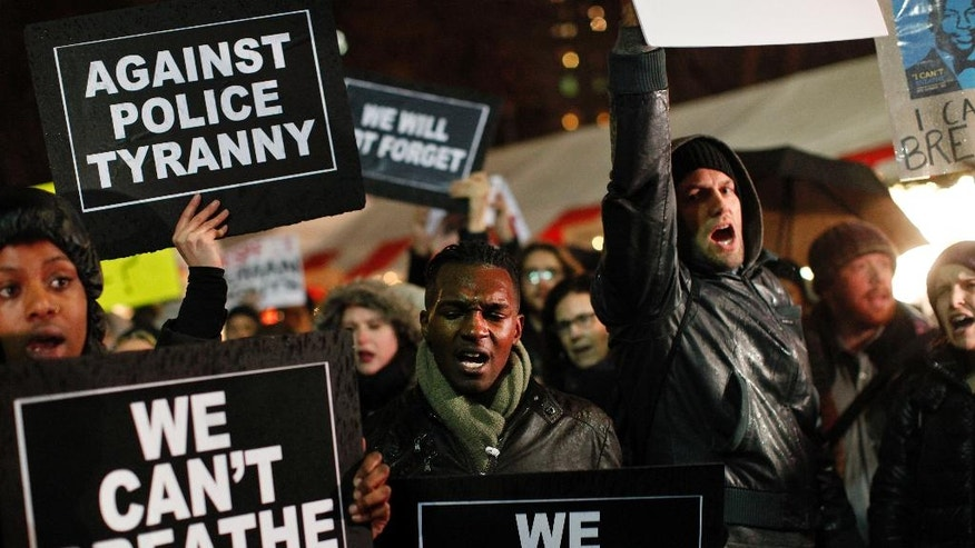"Protesters participate in a ""die-in"" at Bryant Park during a march against a grand jury's decision not to indict the police officer involved in the death of Eric Garner, Friday, Dec. 5, 2014, in New York. (AP Photo/John Minchillo)"