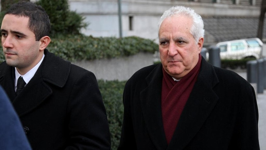FILE - In a Dec. 15, 2010 file photo, Daniel Bonventre, right, a former employee of Bernard Madoff, arrives before appearing in federal court in New York. Bonventre, the first of five ex-employees of imprisoned Ponzi king Bernard Madoff is scheduled to be sentenced Monday, Dec. 8, 2014 after a New York jury convicted them earlier this year.  (AP Photo/Craig Ruttle, File)