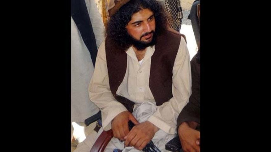 Oct. 4, 2009: In this file photo, Pakistani Taliban commander Latif Mehsud sits with fellows in Sararogha in south Waziristan in Pakistan. (AP)