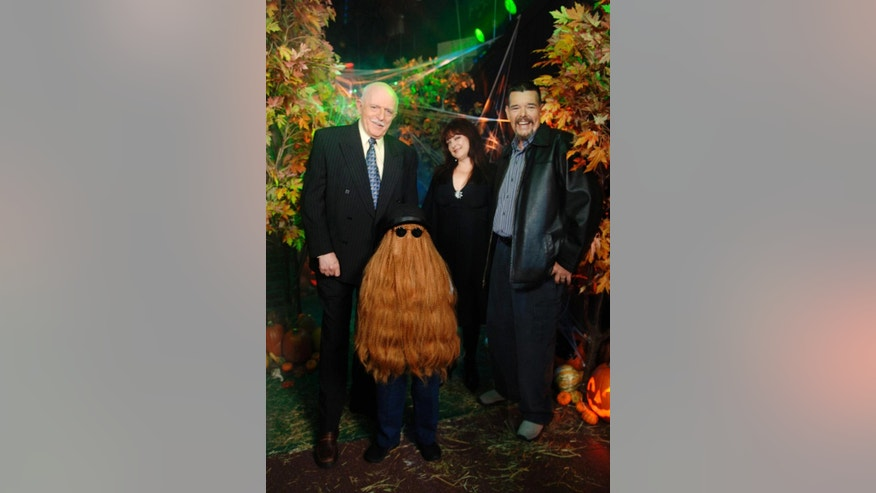 "This Oct. 31, 2006 photo provided by ABC, shows some of the original cast of the TV show, ""The Addams Family,"" from left, John Astin, (Gomez Addams), Felix Silla, (Cousin Itt), Lisa Loring, (Wednesday Addams) and Ken Weatherwax, (Pugsley Addams), reunited at a special Halloween edition of ABC's ""Good Morning America"" outside their Times Square studios in New York.  Weatherwax, who played the child character Pugsley on ""The Addams Family"" television series in the 1960s, has died. He was 59.  (AP Photo/ ABC, Ida Mae Astute)"