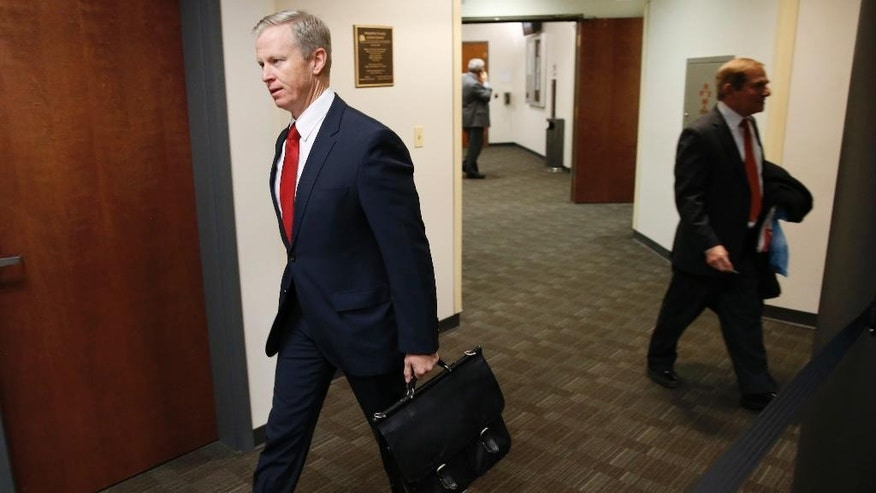 Dec. 8, 2014: George Brauchler, left, district attorney of Arapahoe County, Colo., walks to a pre-trial readiness hearing early in Centennial, Colo., in the murder trial of James Holmes, who is charged with killing 12 moviegoers and wounding 70 more in a shooting spree in a crowded theater in Aurora, Colo., in July 2012. (AP)