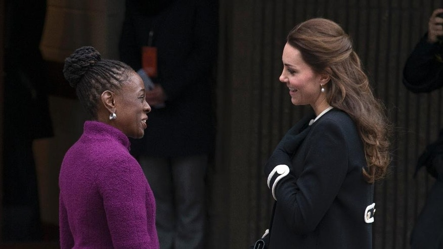 New York City first lady Chirlane McCray, left, and Britain's Kate, Duchess of Cambridge, greet one another outside the Northside Center for Child Development, Monday, Dec. 8, 2014, in New York. Kate and Prince William arrived in New York City on Sunday, their first official visit to the U.S. since a 2011 trip to California and their first taste of the Big Apple. (AP Photo/John Minchillo)