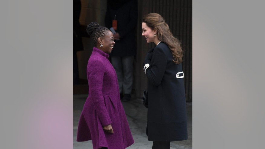 New York City first lady Chirlane McCray, left, and Britain's Kate, Duchess of Cambridge, exchange greetings outside the Northside Center for Child Development, Monday, Dec. 8, 2014, in New York. Kate and Prince William arrived in New York City on Sunday, their first official visit to the U.S. since a 2011 trip to California and their first taste of the Big Apple. (AP Photo/John Minchillo)