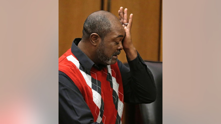 Ronnie Bridgeman, now known as Kwame Ajamu, wipes away tears during a hearing where charges were dismissed Tuesday, Dec. 9, 2014, in Cleveland.  Ajamu, the last of three men convicted and sentenced to death in the 1975 slaying of an Ohio businessman had his charges dismissed.  Ajamu was 17 when he was convicted in the shooting death of Harry Franks outside a Cleveland corner store. Ajamu was released from prison in January 2003 after 27 years behind bars. His brother, Wylie Bridgeman, and their best friend from the neighborhood, Ricky Jackson, were released from prison late last month after serving nearly 40 years.  (AP Photo/Tony Dejak)