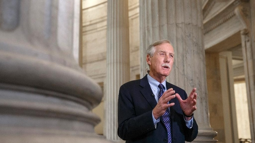 Senate Intelligence Committee member, Sen. Angus King, I-Maine, defends the panel's planned release of a report on the CIA's harsh interrogation techniques, Tuesday, Dec. 9, 2014, during a TV news show interview on Capitol Hill in Washington.  (AP Photo/J. Scott Applewhite)