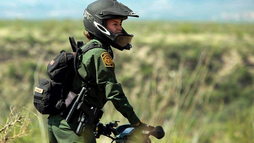 Crystal A. Diaz, a U.S. Border Patrol agent with the Tucson Sector in Arizona, rides her ATV while on patrol.
