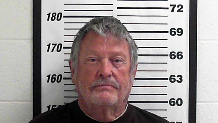 In this undated photo provided by the Davis County Jail Myron Lee Kipp poses for a booking photo, in Utah. A judge is issuing an arrest warrant for the 77-year-old Kipp, who police said was sunbathing nude in his backyard next to a church parking lot. Court records show the $5,000 cash-only warrant was issued Tuesday, Dec. 2, 2014, after Kipp failed to show up at a court hearing in his lewdness case. Police say Kipp's neighbors reported he was sunbathing nude in his backyard March 5. His yard has a chain-link fence with no privacy slats.  (AP Photo/Davis County Jail)