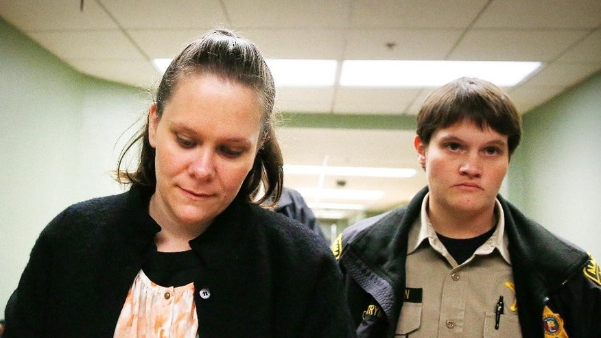 Wendy Wood Holland, left, is lead out of the courtroom after she was found guilty on of sodomy, sexual abuse, sexual torture and child endangerment at Baldwin County Circuit Court, Wednesday, Dec. 10, 2014, in Bay Minette, Ala. Holland was convicted on felony charges as member of a family sex ring that abused children for years. She was among 11 people arrested following the disappearance of her 19-year-old niece Brittney Wood in 2012. (AP Photo/Brynn Anderson)