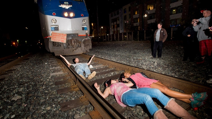 DEc. 8, 2014: Protesters block an Amtrak train in Berkeley, Calif.